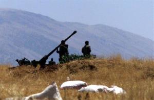 Syrian soldiers prepare an anti-aircraft gun.