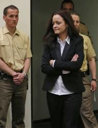 Beate Zschaepe, member of the neo-Nazi group National Socialist Underground (NSU) enters the court room before the start of her trial in Munich, southern Germany, Monday, May 6, 2013.