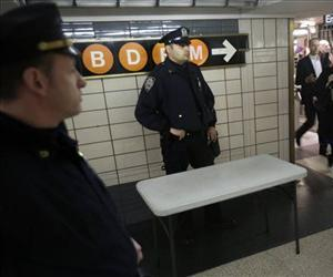 Police officers keep an eye on commuters in a subway station in New York in this file photo.
