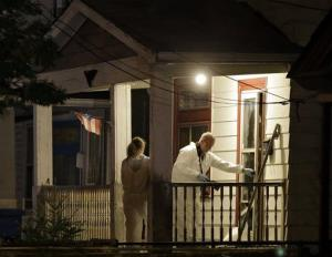 Investigators enter the Castro house on Cleveland's west side.