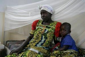 A boy receives medical treatment for severe malaria as his mother looks on at a clinic run by the aid organization Merlin, in Goma, eastern Congo, in this file photo.
