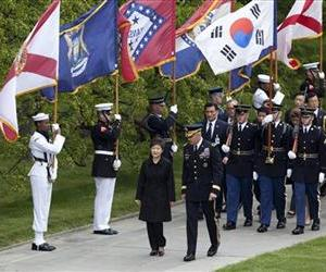 South Korea President Park Geun-hye is escorted by Maj. Gen. Michael Linnington during a wreath laying ceremony at the Tomb of the Unknowns at Arlington National Cemetery,May 6, 2013.