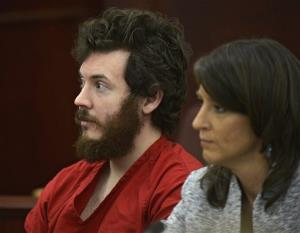 In this March 12 photo, James Holmes and defense attorney Tamara Brady appear in district court in Centennial, Colo.