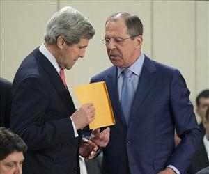 Russian Foreign Minister Sergei Lavrov, right, hands a folder to John Kerry before the start of the NATO- Russia Council meeting at NATO headquarters on Tuesday, April 23, 2013, in Brussels, Belgium.
