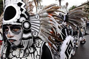 A feathered participant joins in on a procession marking the Dia de los Muertos (Day of the Dead) at the Hollywood Forever Cemetery in Los Angeles on Nov.1, 2008.