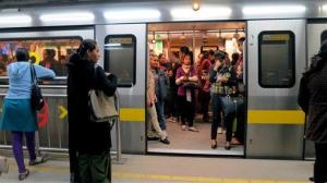 Passengers ride the New Delhi metro rail in this file photo.
