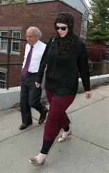 In this April 29, 2013 file photo, Katherine Russell, widow of Boston Marathon bomber suspect Tamerlan Tsarnaev, right, leaves a law office.