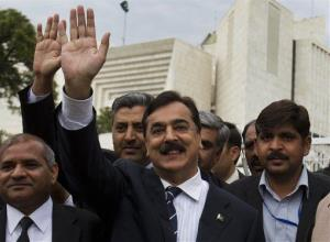 In this Wednesday, March 13, 2013, photo, Pakistan's ousted prime minister Yusuf Raza Gilani waves outside the Supreme Court in Islamabad, Pakistan.
