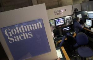 In this March 15, 2012 photo, a trader works in the Goldman Sachs booth on the floor of the New York Stock Exchange.