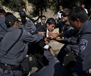 An Ultra-orthodox Jewish man scuffles with Israeli security forces while protesting a prayer by the Women of the Wall, not pictured, at the Western Wall, in Jerusalem's old city, May 10, 2013.