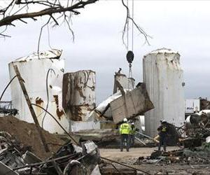 In this May 2, 2013, file photo investigators move and look through the debris of the destroyed fertilizer plant in West, Texas.