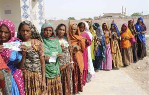 Pakistani women line up outside a polling station waiting to cast their ballots in Hyderabad, Pakistan, Saturday.