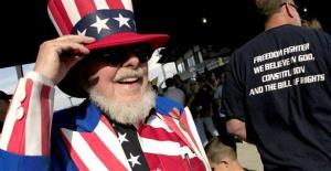 In this file photo, a Tea Party supporter attends a tax day rally in Independence, Mo.