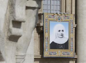 The tapestry of Laura di Santa Caterina da Siena Montoya of Colombia hangs from a balcony in St. Peter's Square prior to a canonization ceremony led by Pope Francis Sunday, May 12, 2013.