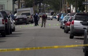 New Orleans Police investigate the shooting at the intersection of Frenchman Street and N. Villere in New Orleans.