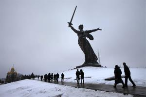 People walk past a monument during ceremonies marking the 70th anniversary of the Battle of Stalingrad in the southern Russian city of Volgograd, once known as Stalingrad, Saturday, Feb. 2, 2013.