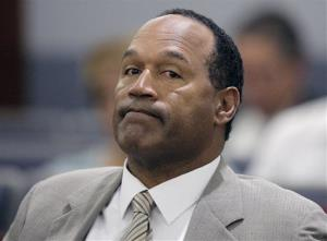 This Monday, Sept. 15, 2008,  file photo shows OJ Simpson appearing in court  for opening statements on the first day his trial in Las Vegas.