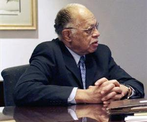 In this March 8, 2010 file photo, Dr. Kermit Gosnell speaks to his attorney in Philadelphia.