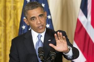 President Barack Obama gestures during a joint news conference with British Prime Minister David Cameron, Monday, May 13, 2013, in the East Room of the White House in Washington.