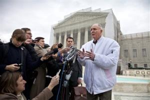 Vernon Hugh Bowman, a 75-year-old Indiana soybean farmer, speaks with reporters outside the Supreme Court in Washington.