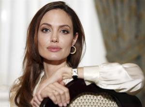 In this Saturday, Dec. 3, 2011 photo, Angelina Jolie poses for a portrait to promote her directorial debut of the film In the Land of Blood and Honey.
