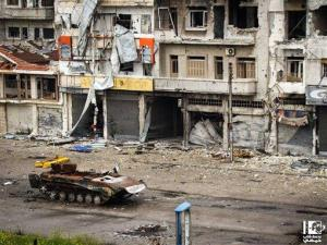 This citizen journalism image shows a destroyed Syrian tank in the al-Qossur neighborhood in Homs province, Syria, Monday, May 13, 2013.