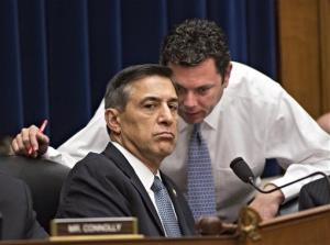 House Oversight Committee Chairman Rep. Darrell Issa, R-Calif., left, confers with Rep. Jason Chaffetz, R-Utah, right, at a House hearing about Benghazi.