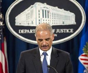 Attorney General Eric Holder pauses during a news conference at the Justice Department in Washington, May 14, 2013.