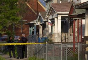 Cleveland police stand outside a home where missing women Amanda Berry, Gina DeJesus, and Michelle Knight were found.