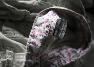 Walmart's Faded Glory label is seen on a piece of clothing found after a garment factory blaze killed 112 workers in Bangladesh last year.