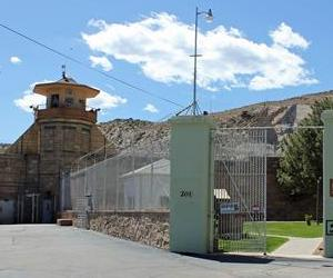 A gate yawns open at a former women's prison in Colorado.