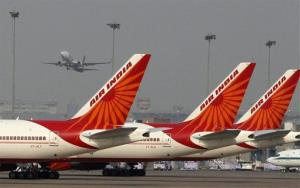 Air India planes are parked in a row.