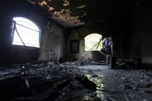 In this Sept. 13, 2012, photo, a Libyan man investigates the inside of the U.S. consulate in Benghazi a day after the attack.