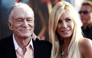 In this April 26, 2010 file photo, Hugh Hefner, left, and Crystal Harris arrive at the premiere of Iron Man 2 at the El Capitan Theatre in Los Angeles.