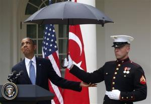 President Obama looks to see if it is still raining as a Marine holds an umbrella for him during his news conference with Turkish Prime Minister Recep Tayyip Erdogan today.