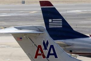 American Airlines and US Airways jets prepare for flight at the Philadelphia International Airport in this file photo.