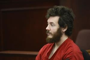 James Holmes, Aurora theater shooting suspect, sits in the courtroom during his arraignment in Centennial, Colo., in a Tuesday, March 12, 2013 file photo.