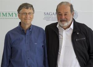 Bill Gates and Carlos Slim pose during the inauguration of a new research center at the International Center for Improvement of Corn and Wheat in Texcoco, Mexico, Wednesday, Feb. 13, 2013.