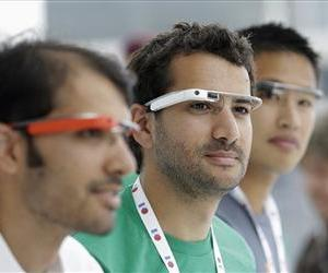 Google Glass team members wear Google Glasses at a booth at Google I/O 2013 in San Francisco, May 15, 2013.