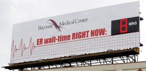 The wait time at the Bayonne Medical Center's emergency room is seen on a billboard.