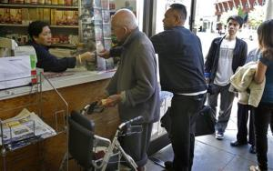People line up to purchase Powerball lottery tickets Saturday, May 18, 2013, in Oakland, Calif.
