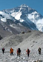 Members of the Chinese Mount Everest expedition team climb up to measure the height of the mountain.