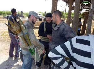 Syrian rebels prepare to repel a coordinated attack by government forces in Qusair, Homs province, Syria yesterday.