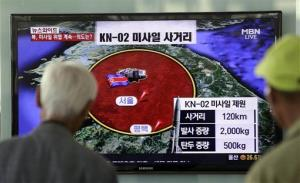 South Korean men watch a TV news program reporting missile launch conducted by North Korea, at a Seoul train station in Seoul, South Korea, Monday, May 20, 2013.