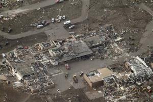 This aerial photo shows damage to Plaza Towers Elementary School after it was hit by a massive tornado in Moore, Oklahoma yesterday.