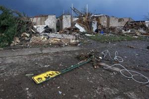 The rubble of a destroyed neighborhood lay where they fell a day earlier Tuesday, May 21, 2013, after a tornado moved through Moore, Okla.