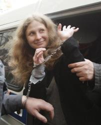 Maria Alyokhina of Pussy Riot is escorted to a courtroom in Moscow, Russia, Thursday, April 19, 2012.