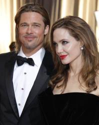 This Feb. 26, 2012 file photo shows actors Brad Pitt, left, and Angelina Jolie at the 84th Academy Awards in the Hollywood section of Los Angeles.