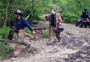 In this May 22 photo, rescue personnel work near the scene of a rockslide in St. Paul, Minn.