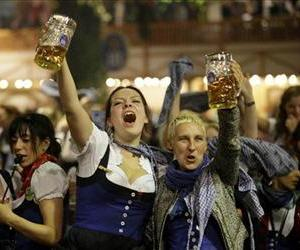 Waitresses dance on tables in a beer tent on the final evening of the famous Bavarian Oktoberfest beer festival in Munich, southern Germany, Sunday, Oct. 7, 2012.